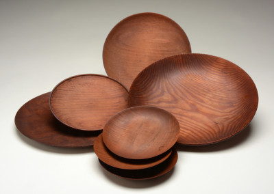Mim Sivohnen, Wooden Plates, ca. 1948, variable dimensions. Black Mountain College Museum + Arts Center Collection. Gift of the artist.