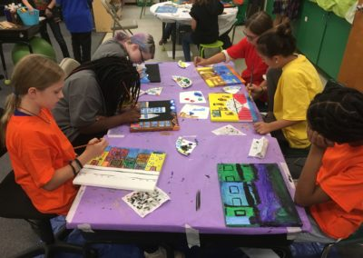 Students at Vance Elementary work with TAPAS Master Teacher Cleaster Cotton to create Lawrence inspired paintings, exhibited at BMCM+AC