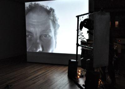 Max VanDerBeek performs at the opening reception of VanDerBeek + VanDerBeek, photo by Ken Fitch